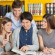 University Students Studying Together In Library — Stock Photo
