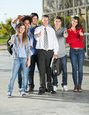 Confident Students And Professor Gesturing Thumbsup On Campus — Stock Photo
