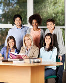 University Students And Professor With Books In Classroom — Stock Photo