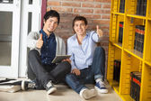 Friends With Digital Tablet Gesturing Thumbsup Library — Stock Photo