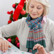 Woman Wrapping Christmas Gift — Stok fotoğraf