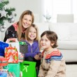 Mother And Children With Christmas Gifts — Stock Photo