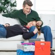 Loving Couple With Christmas Gifts Relaxing At Home — Stock Photo #33920377