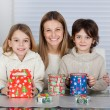 Mother And Children With Christmas Presents — Stock Photo