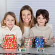Stock fotografie: Mother And Children With Christmas Presents