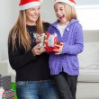Cheerful Daughter And Mother With Christmas Present — Stock Photo