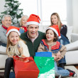 Happy Family With Gifts During Christmas — Stock Photo