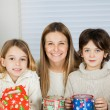 Happy Mother And Children With Christmas Gifts — Stock Photo