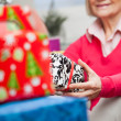 Senior Woman Holding Christmas Present — Stock Photo