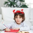 Boy Wearing Headband Writing Letter To Santa Claus — 图库照片