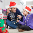 Father And Daughter Holding Christmas Ornaments — Stock Photo