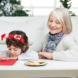 Grandmother Looking At Boy Writing Letter To Santa Claus — Foto Stock