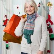 Senior Woman With Shopping Bags During Christmas — Stock Photo