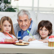 Grandfather And Children With Cardpapers — Stock Photo #33924257