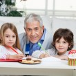 Grandfather And Children With Cardpapers — Stock Photo