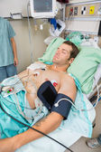 Patient With Holter Monitor Sleeping In Examination Room — Foto Stock