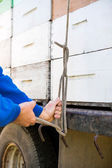 Beekeeper Tying Stacked Honeycomb Crates On Truck — Stock Photo