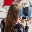 Mother Photographing Family Through Smartphone — Stock Photo