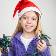 Girl In Santa Hat Holding Fairy Lights — Stock Photo