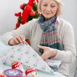 Woman Wrapping Christmas Present — Stok fotoğraf