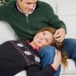 Couple Relaxing On Sofa During Christmas — Stock Photo #33964271