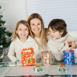 Stock Photo: Loving Mother And Siblings With Christmas Presents