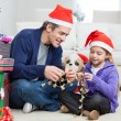 Stock fotografie: Girl And Father Holding Christmas Ornaments