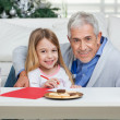 Stock Photo: Happy Grandfather And Girl With Cardpaper