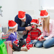Stock Photo: Family With Christmas Gifts And Ornaments