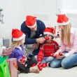 Family With Christmas Gifts And Ornaments — Stock Photo