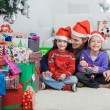 Siblings With Father At Home During Christmas — Stock Photo