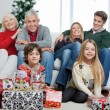 Family With Christmas Gifts In House — Stock Photo #33967409