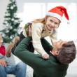 Stock Photo: Daughter Being Carried By Father During Christmas