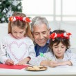 Grandfather Assisting Children In Writing Letters To Santa Claus — Stock Photo