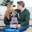 Couple With Christmas Presents Sitting On Floor — Stock Photo