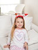 Cute Girl Wearing Santa Headband At Home — Stock Photo