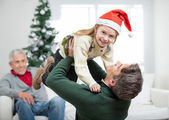 Daughter Being Carried By Father During Christmas — Stock Photo