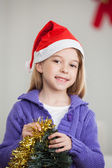 Smiling Girl Holding Tinsels During Christmas — Stock Photo