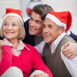 Loving Son With Parents Wearing Santa Hats — Stock Photo