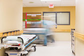 Nurses With Stretcher Walking In Hospital Corridor — Stock Photo