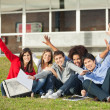 Students With Hands Raised Sitting At University Campus — Stock Photo