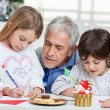 Grandfather Assisting Children In Writing Letters To Santa Claus — Stock Photo #34001759
