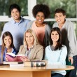 Students And Teacher With Books Smiling In Classroom — Stock Photo #34002363