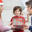 Boy Receiving Christmas Gift From Parents — Stock Photo