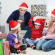 Playful Family With Christmas Gifts — Stock Photo #34004537