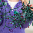 Girl Holding Tangled Fairy Lights — Stok Fotoğraf #34004677