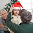 Father Adjusting Girl's Santa Hat — Stock Photo