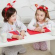 Siblings Writing Letters To Santa Claus — Stockfoto