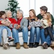Family With Christmas Presents Sitting On Sofa — Stock Photo