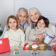 Children And Grandparents With Christmas Gifts — Stock Photo